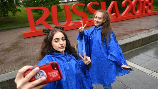 Girls take a selfie by the Russia 2018 sign of the 2018 FIFA World Cup in Yekaterinburg, Russia.
